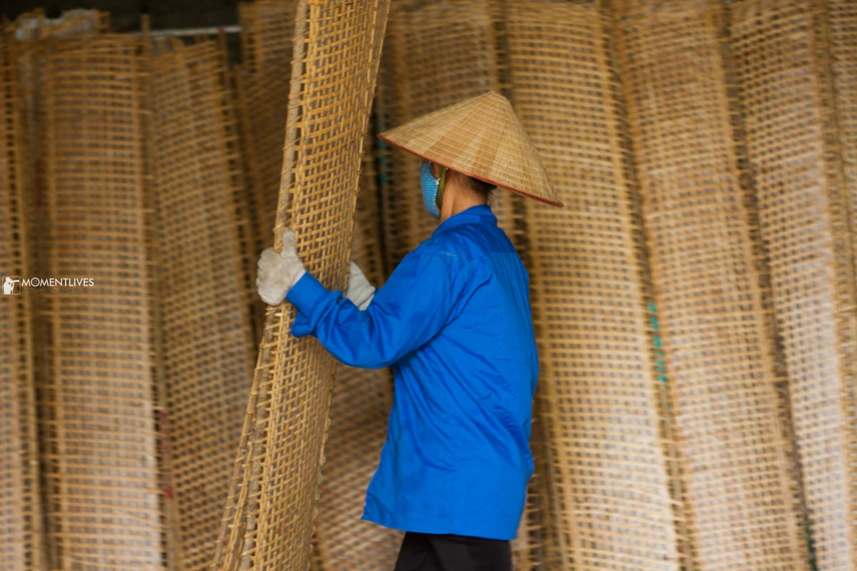 A lady in Tho Ha village carrying bamboo racks