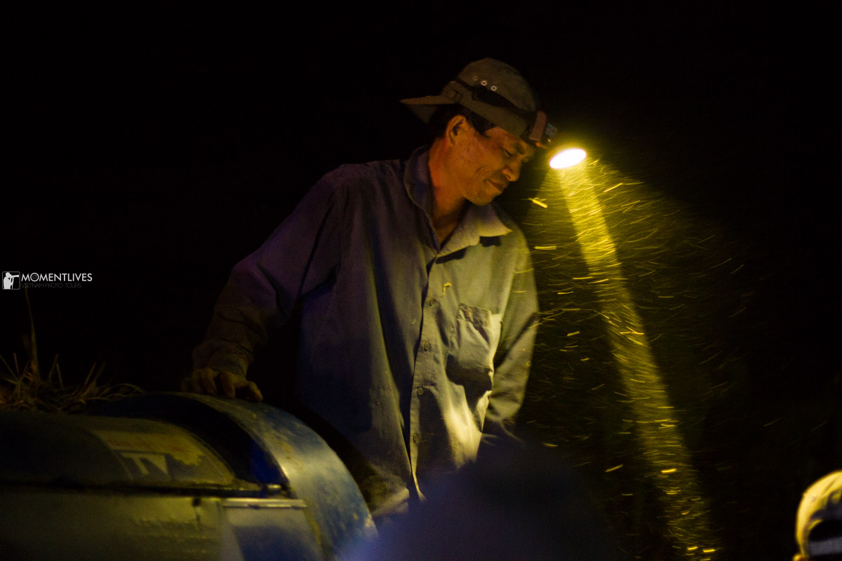 A man working at night in northern Vietnam