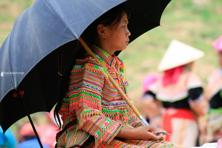 Photograph of a local girl in umbrella