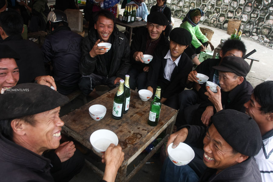 Group of men drinking in a market of Ha Giang