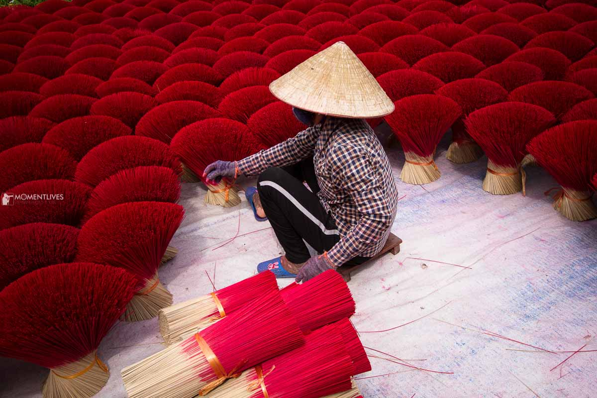 A lady collecting incense on our Vietnam photo tours
