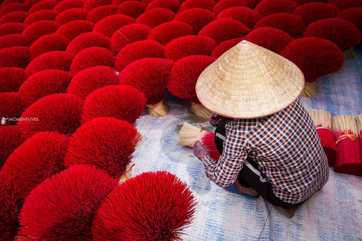 A lady picking incense sticks on our Vietnam photo tours
