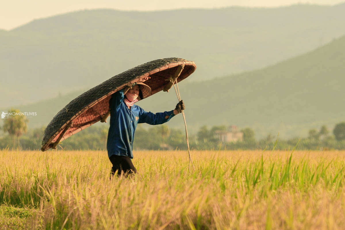 A farmer carrying a boat that we met on our Vietnam photography tour