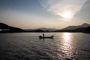 Fisherman in Thac Ba lake, Vietnam