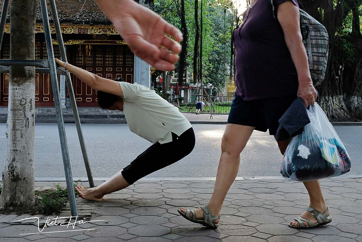 Lady doing exercise in the street of Hanoi