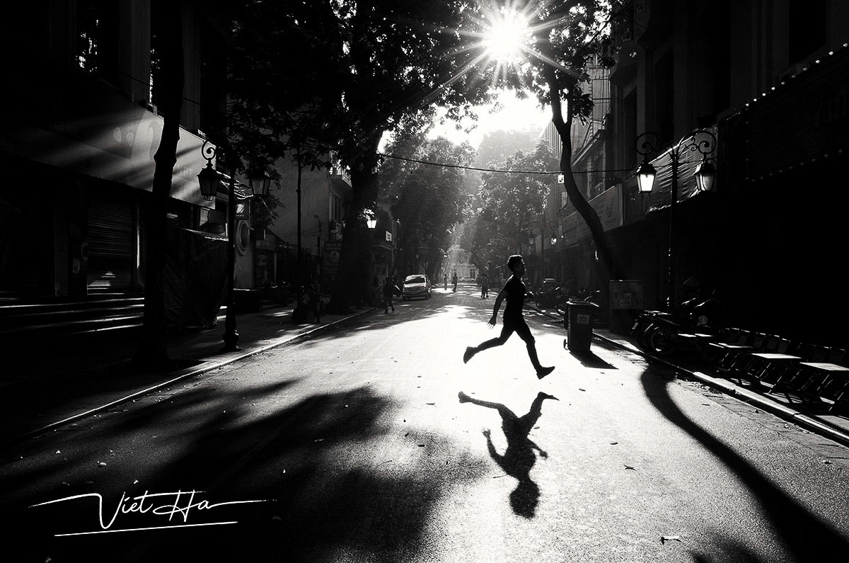 Man jogging in the street of Hanoi, morning photography