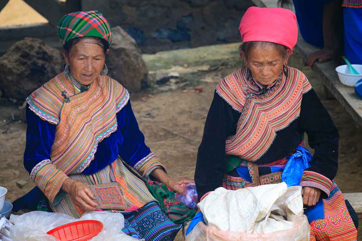 Ladies selling liquor in the market of Bac Ha