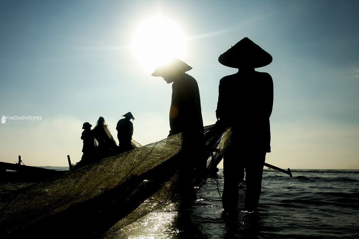 Silhouette photography of fisherman in Nam Dinh, Vietnam